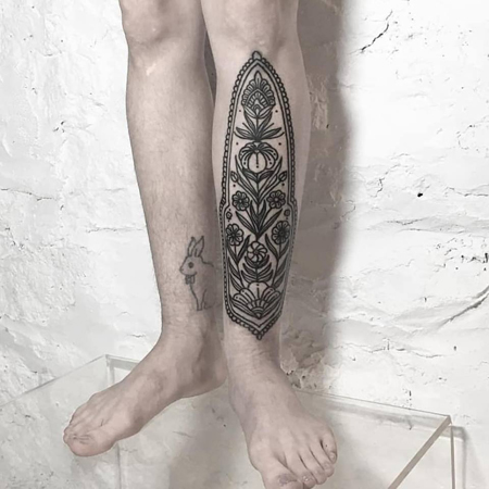 Ornamental tattoo by queer tattoo artist Ciara Havishya.